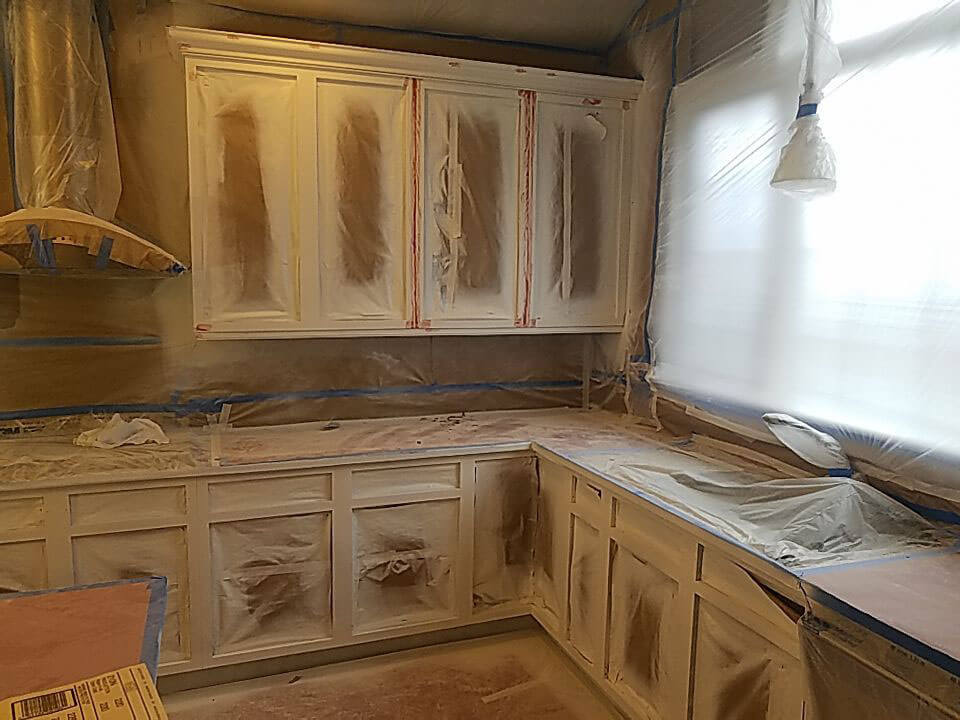 ELCO Painting Rhode Island cabinet sanded before painting services